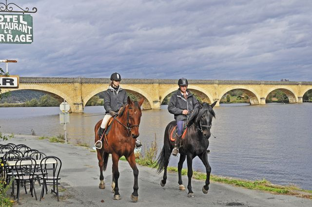 Riders near bridge